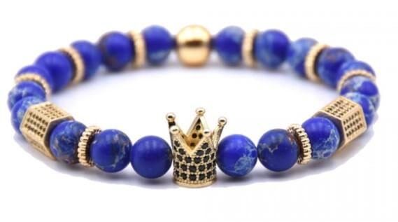 Blå sten armbånd med gulddetaljer